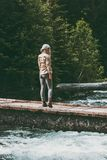 Woman alone standing on bridge over river wanderlust Travel Lifestyle. Concept wild forest nature summer journey vacations outdoor Royalty Free Stock Photography