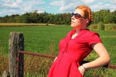 Woman along a fence Stock Photos