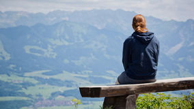 Woman on Alpine Trail Bench Stock Photos