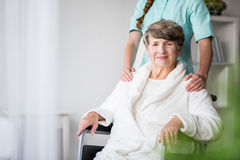 Woman with alzheimer having support. Picture of women with alzheimer having support and care Royalty Free Stock Image