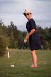 Woman, amateur, playing golf Stock Images