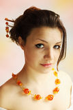 Woman in the amber necklace Stock Images