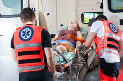 Woman in ambulance. Woman after accident in ambulance, horizontal royalty free stock photography