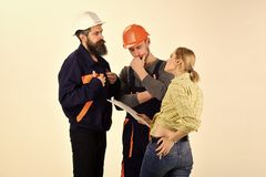 Woman amend plan of repair. Brigade of workers, builders in helmets, repairers, lady arguing, discussing contract, white. Background. Supervisor not satisfied stock photos