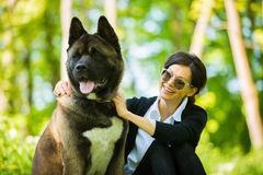 Woman with an American Akita dog stock photos