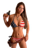 Woman in American Flag bikini with a gun Royalty Free Stock Photos