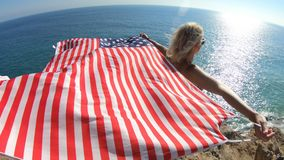 Woman with American flag in California stock video