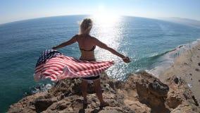 Woman with American flag in Malibu stock video
