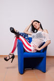 Woman in American flag pants Stock Photo