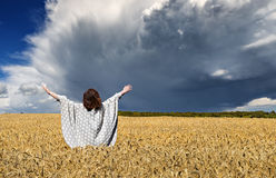 Woman amomg field of wheat before thunderstorm Royalty Free Stock Photos