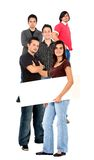 Woman amongst men with banner Royalty Free Stock Photography