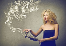 Woman with and amphora. Woman holding an amphora whose coming out incense Stock Photography
