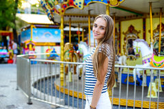 Woman in the amusement park Royalty Free Stock Photography