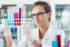 Woman analyzing test tube with liquid Royalty Free Stock Photography