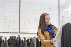 Woman analyzing top in store Royalty Free Stock Photography
