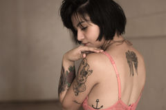Woman With Anchor Tattoo in Pink Bra Stock Photography
