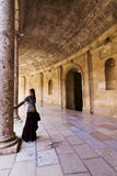Woman in ancient corridor Royalty Free Stock Photography