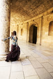 Woman in ancient corridor Stock Photos