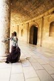 Woman in ancient corridor Stock Photos