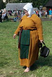 Woman in ancient dress with apron and cap Royalty Free Stock Photos