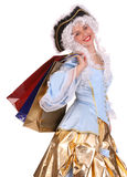 Woman in ancient dress  with gift bag. Stock Photos