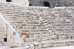 The woman in the ancient Roman amphitheater Stock Images