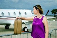Woman And Airpalne Royalty Free Stock Photography