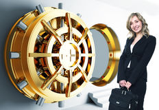 Woman And Bank Vault Stock Photo