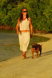 Woman And Dog In Caribbean Royalty Free Stock Images