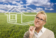 Free Woman And Grass Field With Ghosted House Figure Behind Royalty Free Stock Photo - 45955275