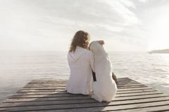 Free Woman And Her Dog Admire Together The View Royalty Free Stock Photo - 99874835