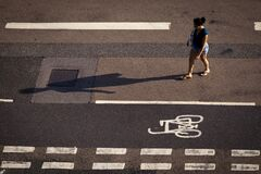 Free Woman And Her Shadow Crossing Lines On The Road Royalty Free Stock Images - 175389339