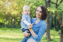 Free Woman And Her Son Rest In The Summer Garden Royalty Free Stock Photography - 115362607