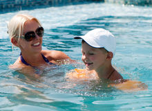 Free Woman And Little Boy Bathes In Pool Stock Photos - 15992893