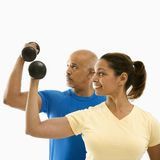 Woman And Man Exercising. Stock Image