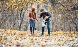 Free Woman And Man Petting The Dog Walking Her In A Colorful Fall Setting Stock Photo - 160846050