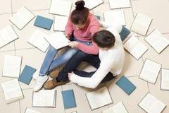 Woman And Man Reading Book Stock Photos