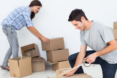 Free Woman And Man Wrapping Boxes Stock Photography - 32513262