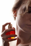 Woman And Perfume Royalty Free Stock Photos