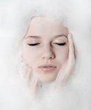Woman And White Foam Stock Photos
