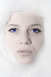 Woman And White Foam Stock Image