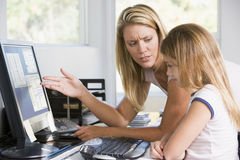Woman And Young Girl In Office With Computer Royalty Free Stock Image