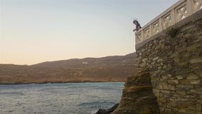 Woman in Andros island in Greece seeing the view in slow motion. stock video footage