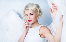 Woman angel. Beautiful model with makeup and angel wings Stock Photos