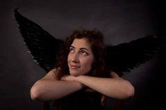 Woman an angel with black wings Stock Photo