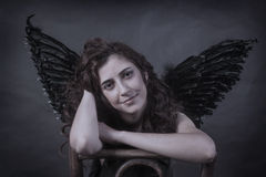 Woman an angel with black wings Royalty Free Stock Photos