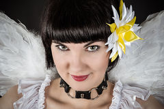 Woman an angel with a collar with spikes Stock Images