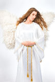 Woman in angel costume. With artificial feather wings isolated on white background spirituality purity dreams religion Stock Images