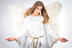 Woman in angel costume. With artificial feather wings isolated on white background spirituality purity dreams religion Stock Photos