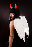 Woman is an angel and  devil Royalty Free Stock Photos